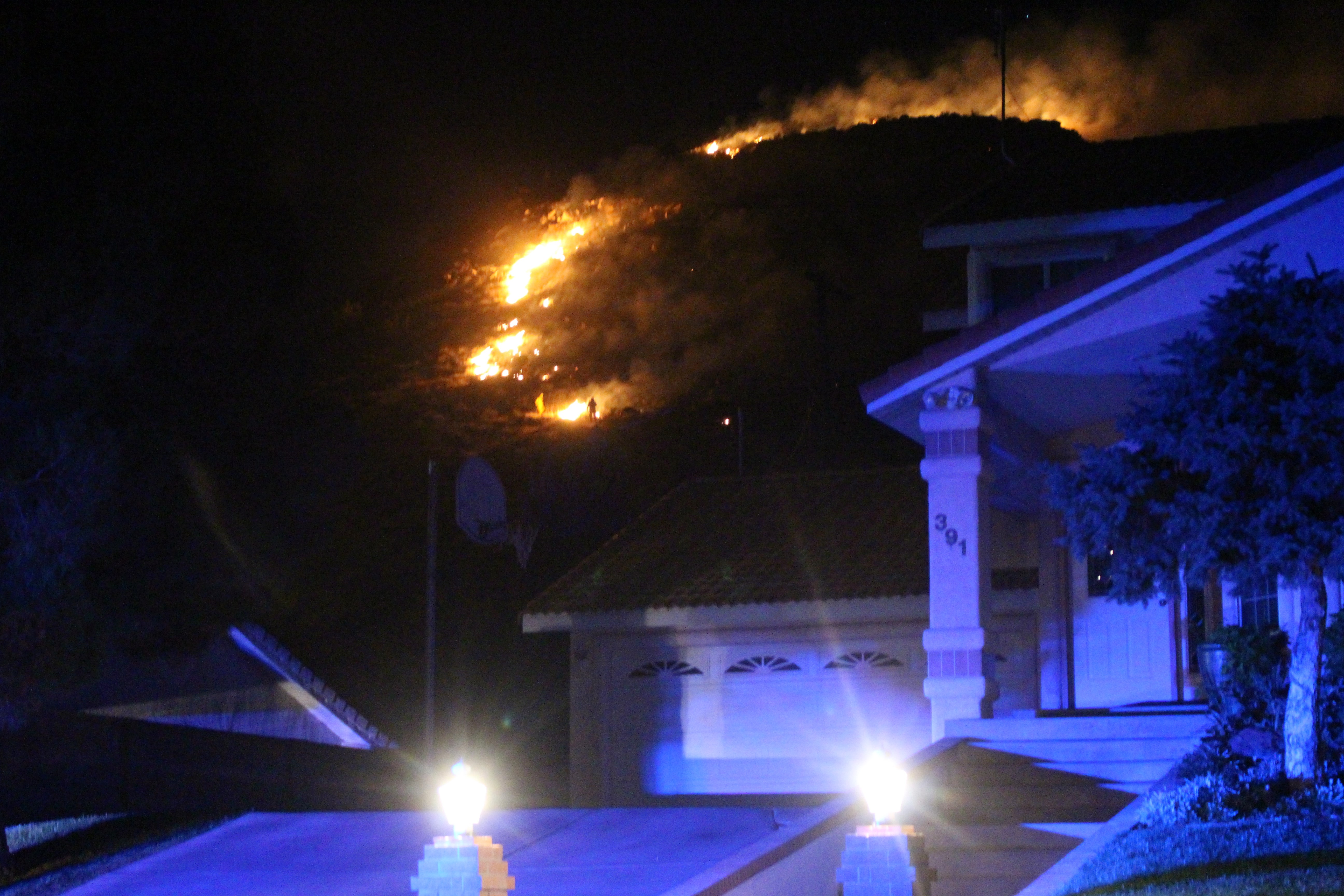 An early morning fire that the fire chief said was likely human-caused burned less than 200 feet from some homes on Donlee Drive, St. George, Utah, July 24, 2016   Photo by Cody Blowers, St. George News