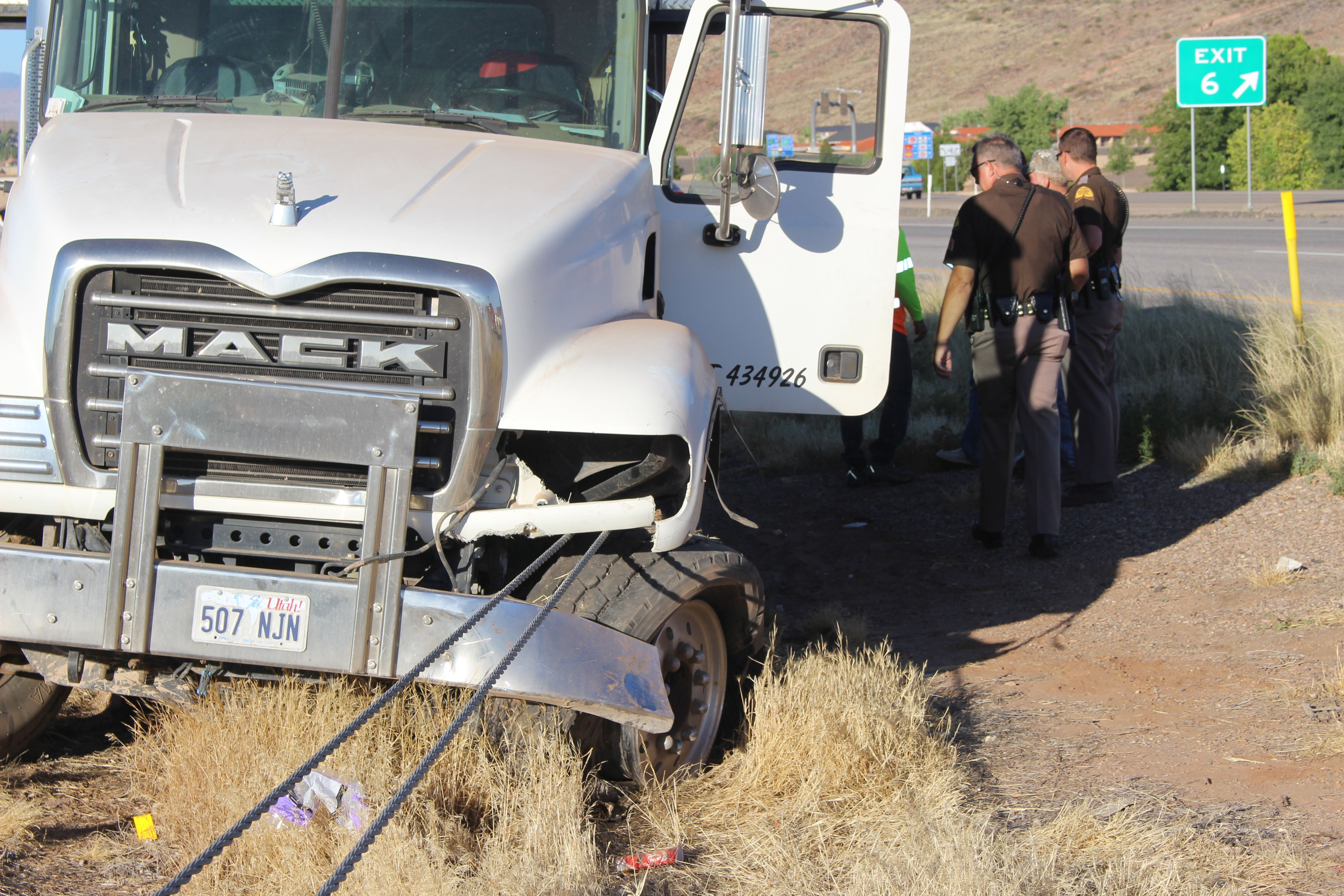 A truck blew a front tire and took out about 300 feet of cable barrier on Interstate 15 Saturday morning. St. George, Utah, July 16, 2016 | Photo by Ric Wayman, St. George News