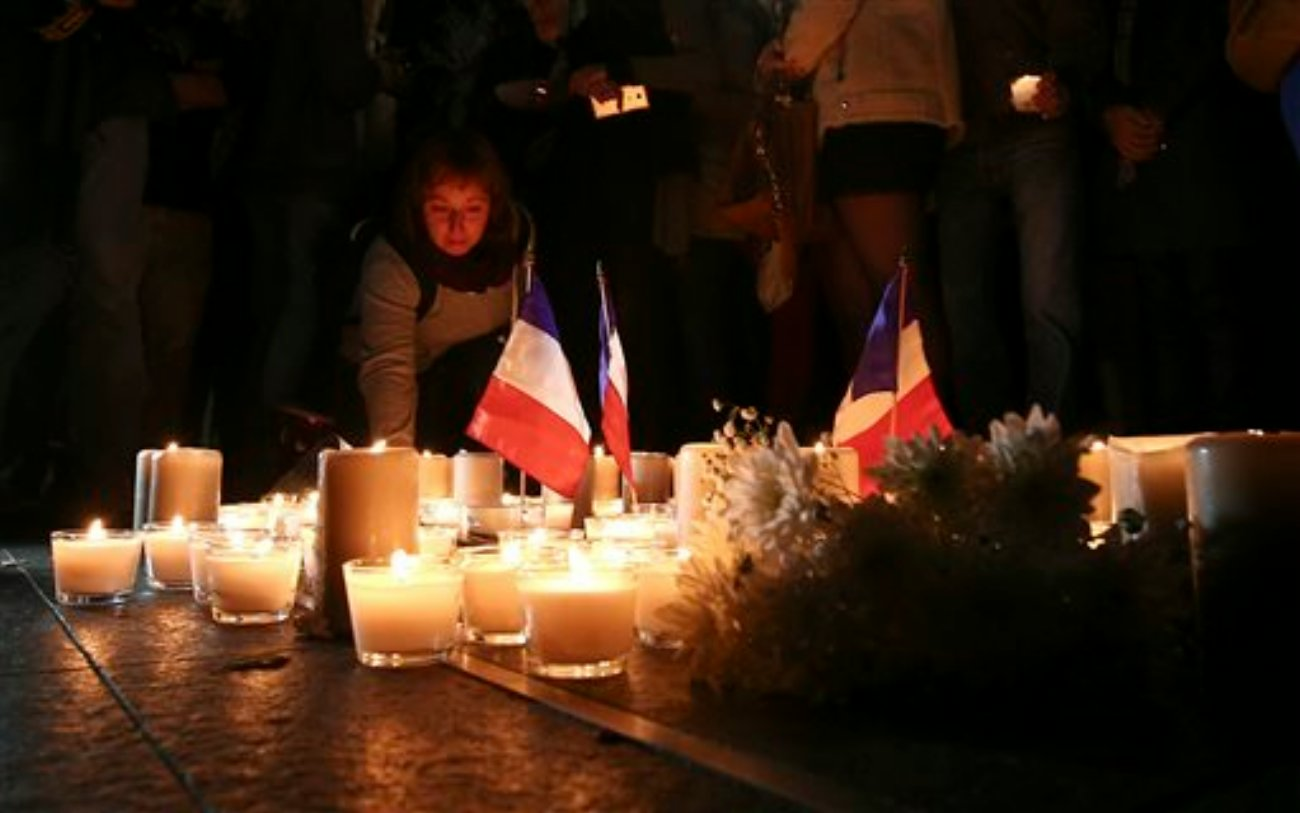 A woman places a candle during a vigil to honor victims of the Bastille Day tragedy in Nice, France, in Sydney, Australia. World leaders are expressing dismay, sadness and solidarity with France over the attack carried out by a man who drove truck into crowds of people celebrating France's national day in Nice, Sydney, Australia, July 15, 2016 | AP Photo by Rob Griffith. St. George News