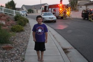 Cassius Sanchez alerted his father to the fire in residential neighborhood stated by fireworks, St. George, Utah, July 24, 2016 | Photo by Cody Blowers, St. George News