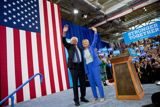Democratic presidential candidate Hillary Clinton and Sen. Bernie Sanders, I-Vt., wave to supporters as Sanders endorsed Clinton during a rally in Portsmouth, N.H., Tuesday, July 12, 2016. (AP Photo/Andrew Harnik)