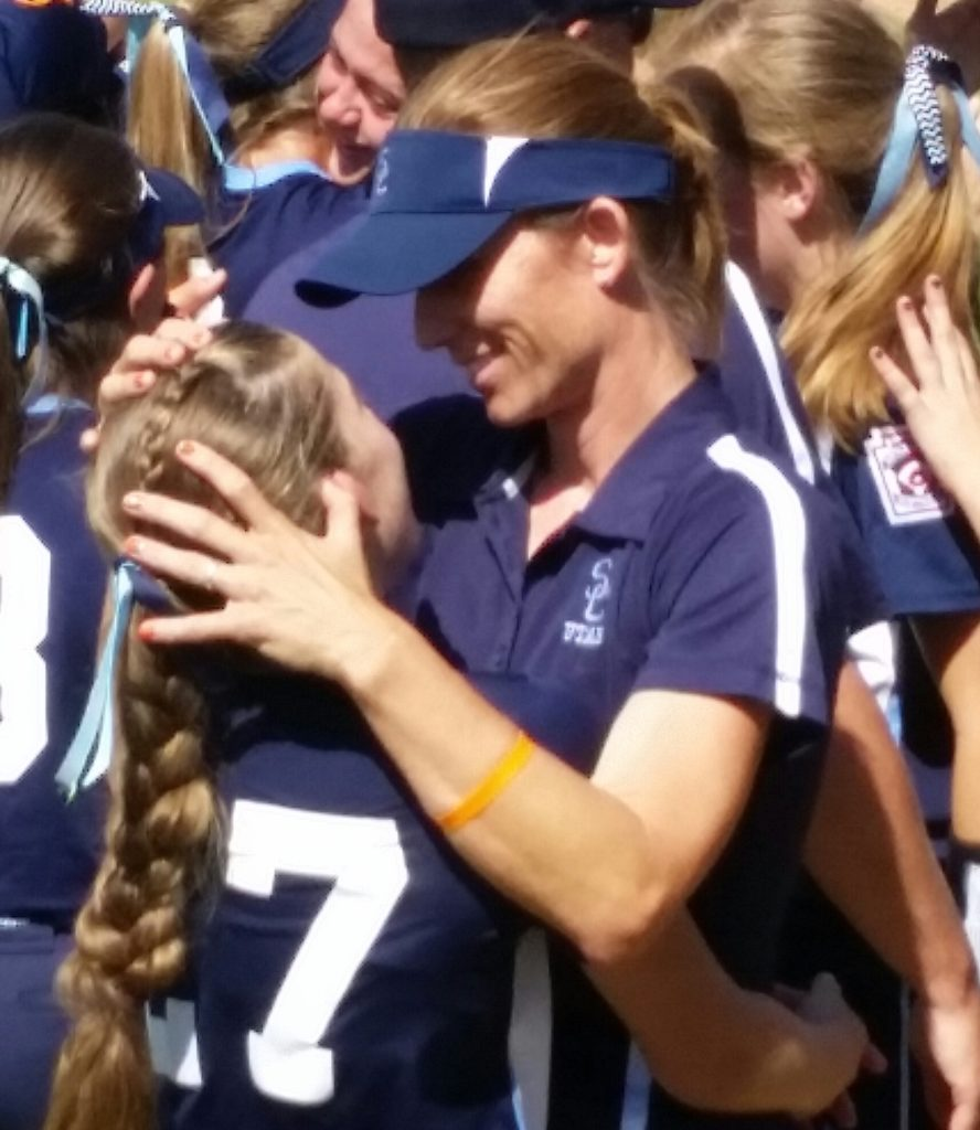 Coach Markay Thorkelson (right) embraces her daughter jenna, Thursday at the Western Regional semifinals Jul. 28, 2016, in San Bernardino, Calif. | Photo by Dennis Pope, special to St. George News