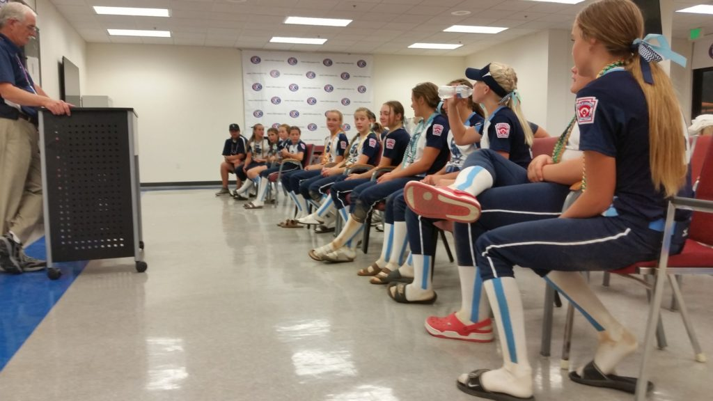 Snow Canyon players and coaches listen to LL Western Region director Dave Bonham about the team's next steps toward the Softball World Series in Portland, Ore., Aug. 10-17, Jul. 29, 2016, in San Bernardino, Calif. | Photo by Dennis Pope, special to St. George News