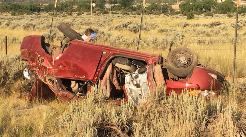 Law enforcement officials found a single vehicle which rolled off Interstate 15 Monday morning. No one was inside the vehicle when officers arrived, Washington County, Utah, July 25, 2016 | Photo by Mike Cole, St. George News