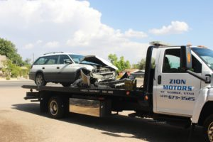 White Subaru involved in two-car collision when driver runs red light on 400 East and 100 South Sunday, July 24, 2016 | Photo by Cody Blowers, St. George News