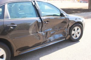 Dark Blue Chevrolet 4-door involved in collision on 100 South and 400 East where two people were injured , St. George,Utah, July 24, 2016 | Photo by Cody Blowers, St. George News