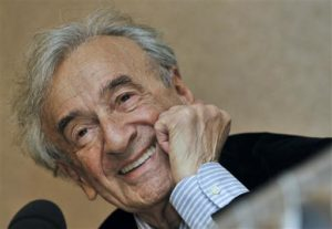 In this file photo, Elie Wiesel smiles during a news conference. Wiesel, the Nobel laureate and Holocaust survivor has died. His death was announced July 2, 2016 by Israel's Yad Vashem Holocaust Memorial. Budapest, Hungary, December 10, 2009   File photo by Bela Szandelszky (AP), St. George News