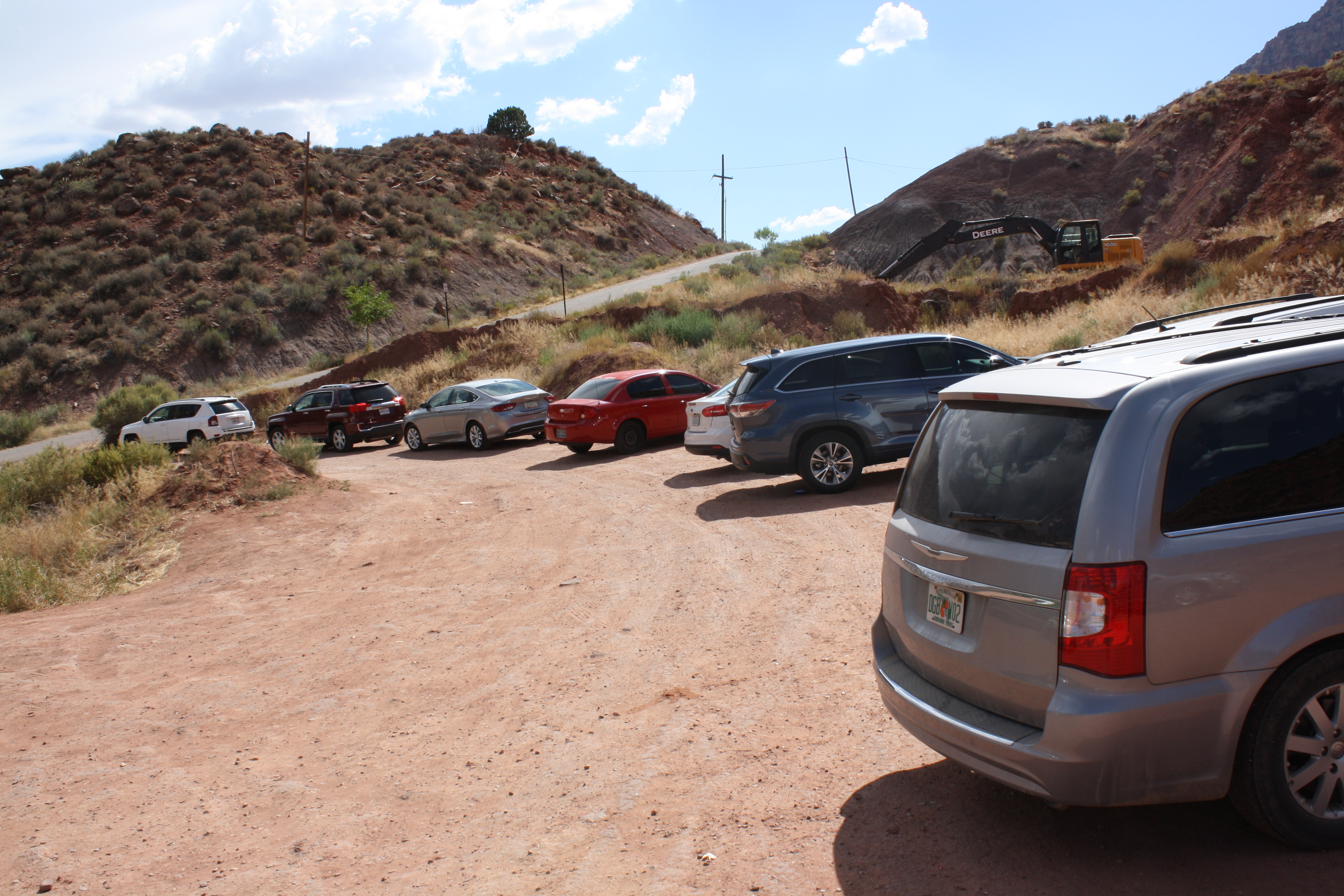 Cars parked along a dirt strip adjacent to Balanced Rock Road in Springdale, the future site of a new parking structure just approved by the Springdale Town Council on Aug. 10. Springdale, Utah, July 20, 2016 | Photo by Reuben Wadsworth, St. George News