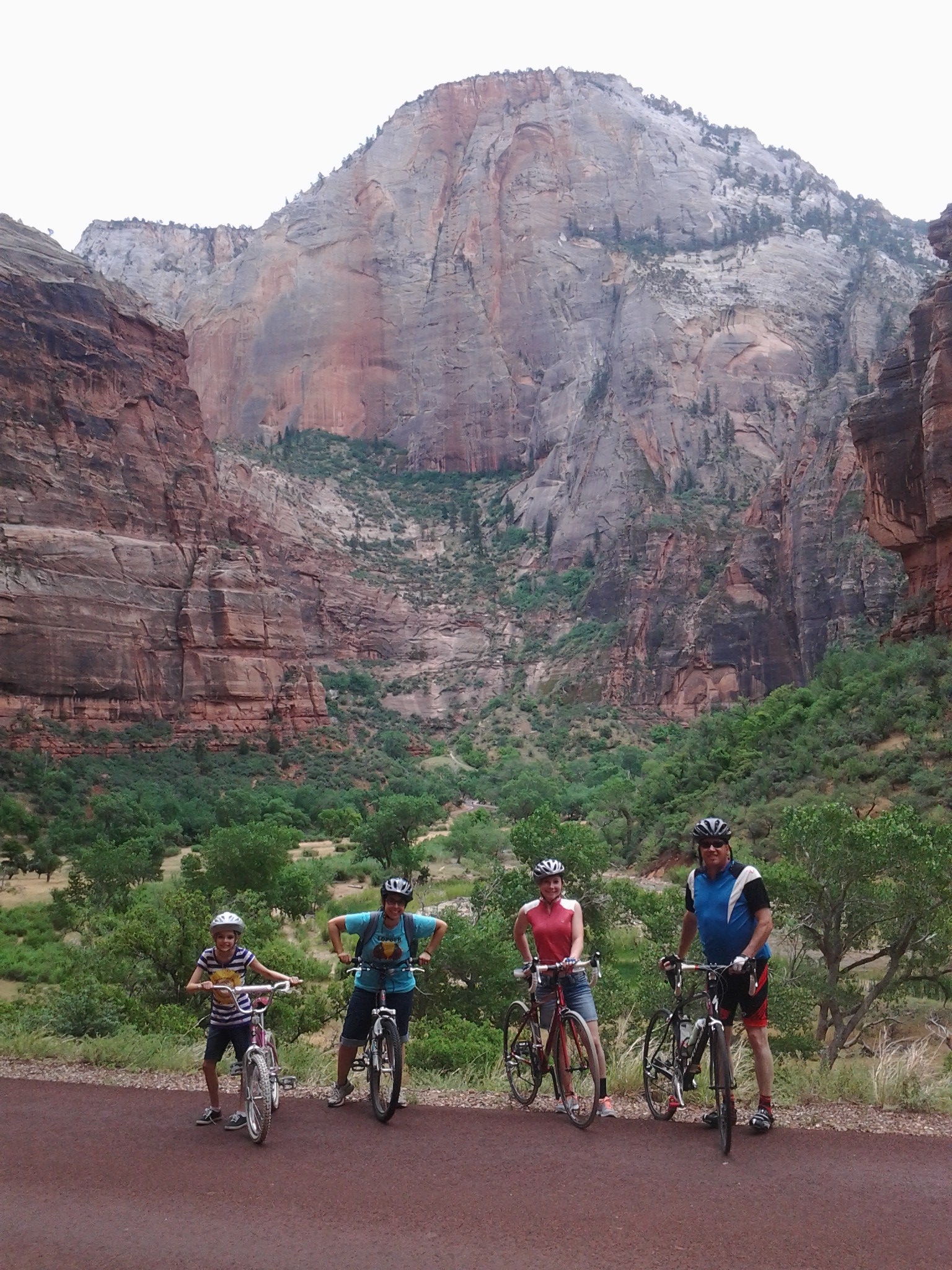 (L-R), Leah Wadsworth, Melissa Wadsworth, Caitlyn Hunsaker, and Scott Hunsaker, pausing for a photo opportunity during a bicycle ride through Zion Canyon, Utah, July 1, 2016   Photo by Reuben Wadsworth, St. George News