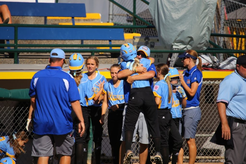 Hugs after scoring a run at the Little League Softball World Series, Snow Canyon vs. Netherlands, Portland, Ore., Aug. 17, 2016 | Photo by Scott Miller, special to St. George News