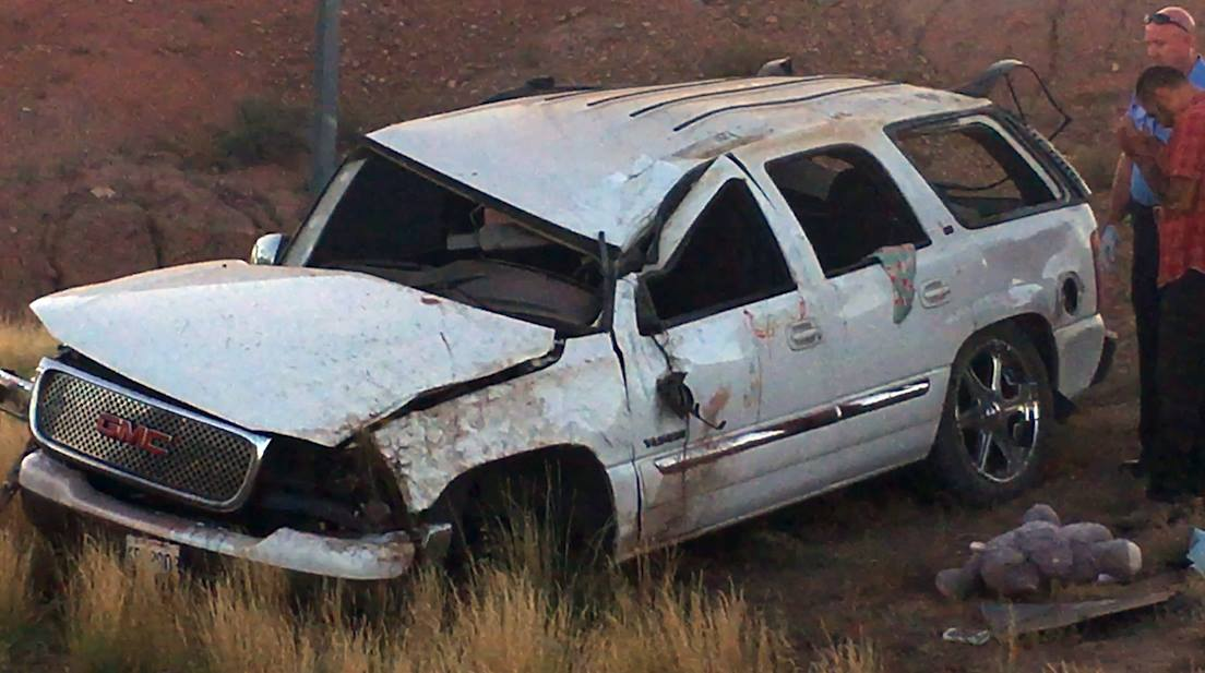 A family of five from Azusa, California, was transported to the hospital after the father fell asleep at the wheel of an SUV and crashed along Interstate 15 near milepost 3, leaving a mother and her 9-year-old son in critical condition, St. George, Utah, Aug. 8, 2016 | Photo by Mike Cole, St. George News
