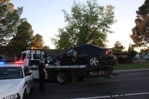 Black Volkswagen Jetta on tow truck after rollover in Santa Clara Sunday evening, Santa Clara, Utah, Aug. 14, 2015 | Photo by Cody Blowers, St. George News