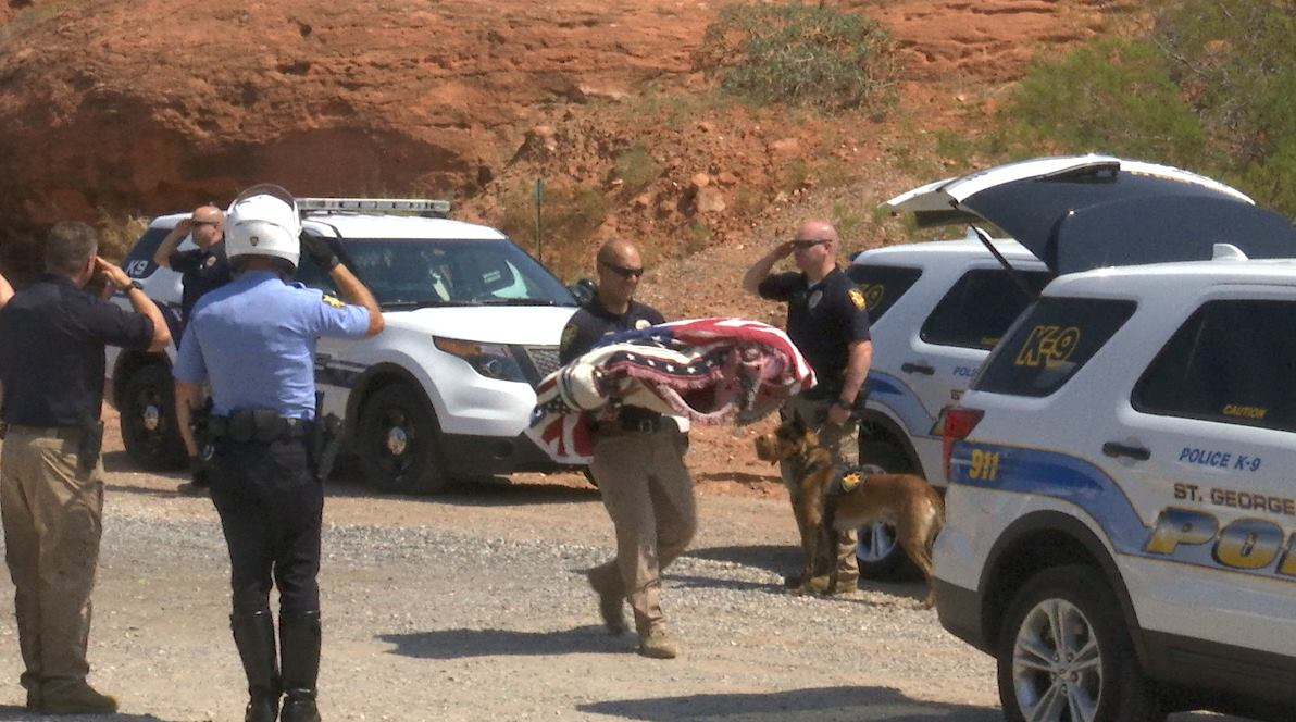 St. George Police Officer Joe Watson carries the body of his K-9 counterpart, Officer Rossko, who died from complications of gastric dilation volvulus, St. George, Utah, Aug. 25, 2016   Photo by Mike Cole, St. George News