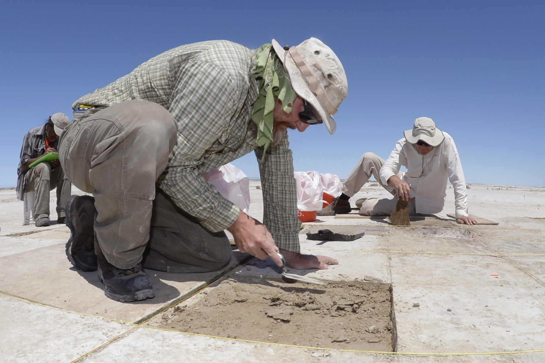 Eric Gingerich, foreground, and Kelly McGuire, both with Far Western Anthropological Research Group, work at a dig site on the Utah Test and Training Range, July 13, 2016. Artifacts found at the site included water fowl bones, seeds, and a large spear tip. | U.S. Air Force photo by Todd Cromar; St. George News