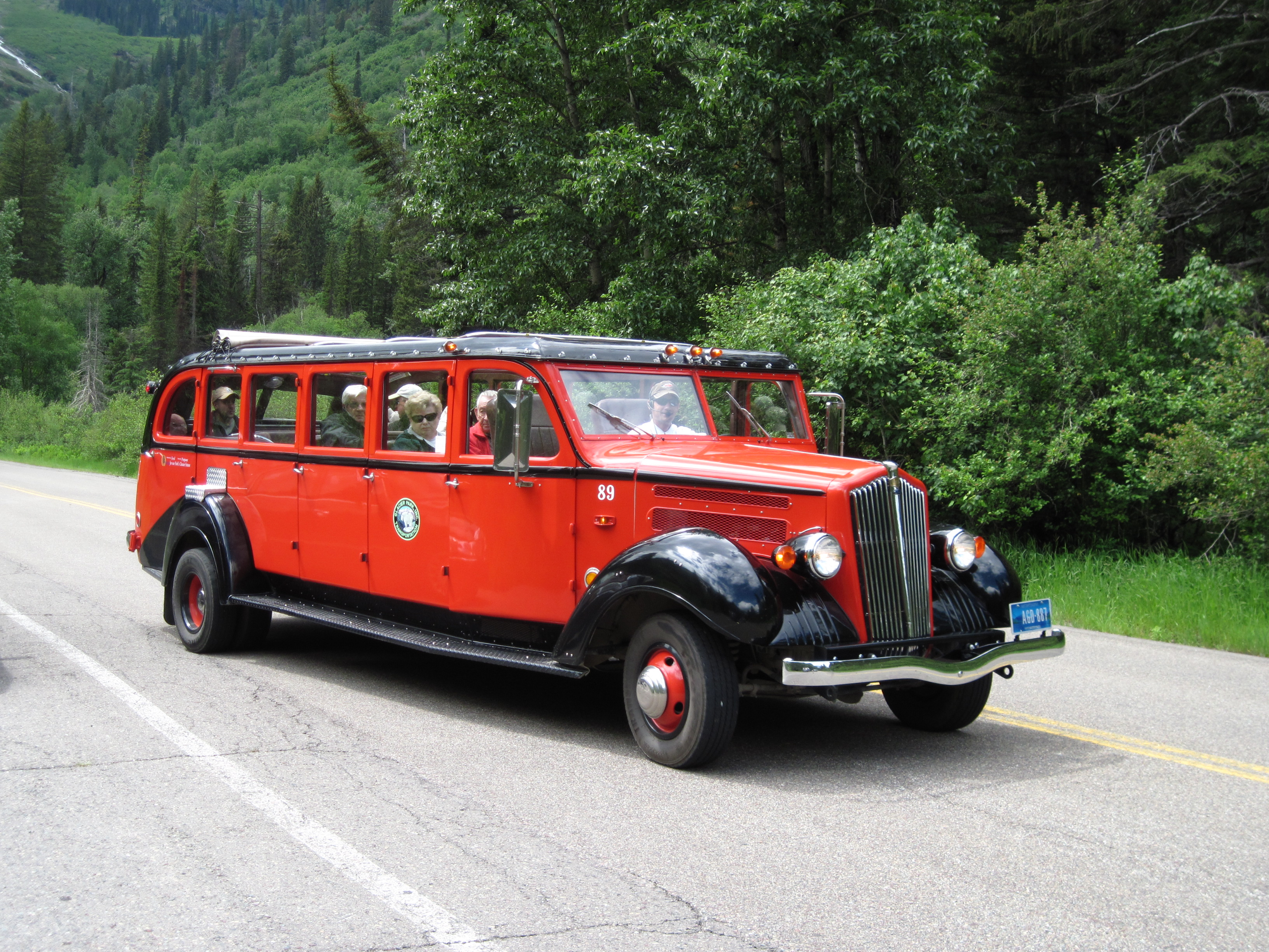 Glacier National Park visitors enjoy a ride in a vintage 1930s-era bus, Glacier National Park, Montana, June 21, 2009   Photo courtesy Melanie Walden, St. George News