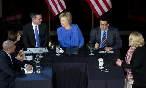 In this March 24, 2016 file photo, Democratic presidential candidate Hillary Clinton looks at Los Angeles Mayor Eric Garcetti, third from left, as she participates in a roundtable with Muslim community leaders at the University of Southern California in Los Angeles. Seated with Clinton from left are City of Los Angeles General Manager, Emergency Management Department James Featherstone, Senior Policy Analyst City of Los Angeles Human Relations Commission & Adjunct Assistant Professor (CSUDH) Joumana Silyan-Saba, Garcetti, President of the Muslim Public Affairs Council, Salam Al-Marayati, and Exucutieve Director of the Center for Religion and Civic Culture Brie Jeanette Loskota. AP Photo/Carolyn Kaster, File; St. George News
