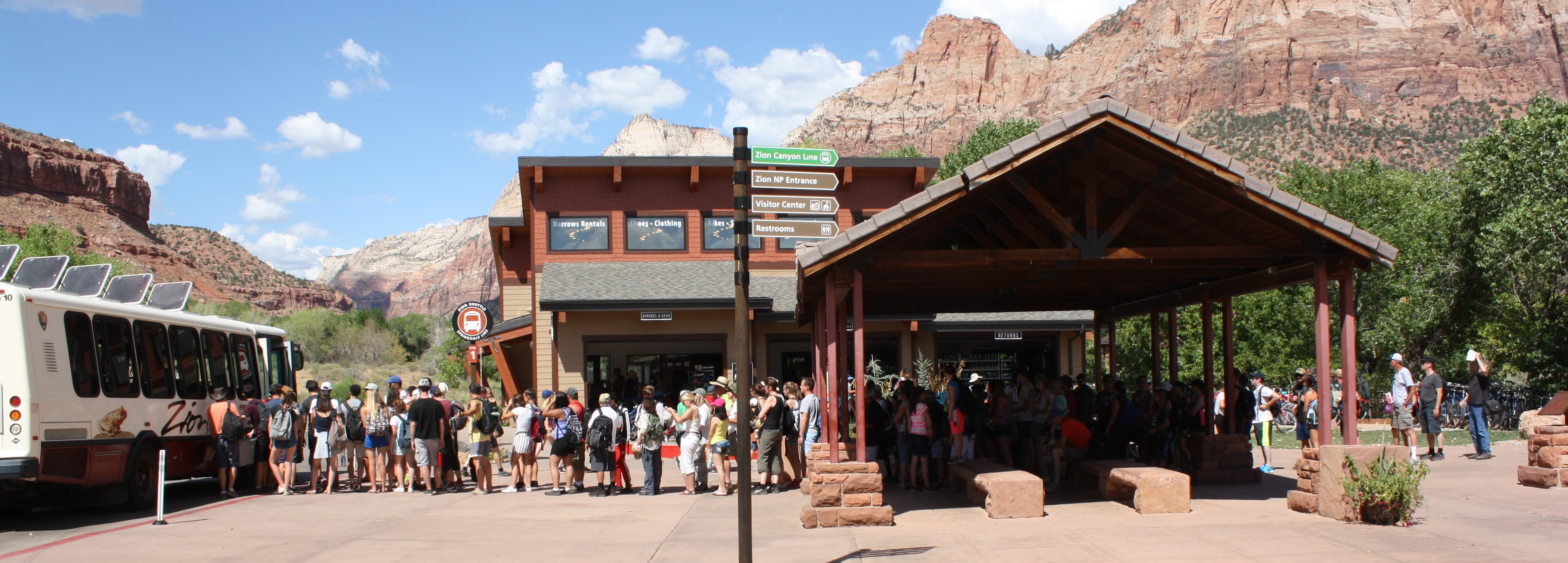 Long line to board the Springdale Shuttle at Zion's pedestrian entrance, Springdale, Utah, July 20, 2016 | Photo by Reuben Wadsworth, St. George News