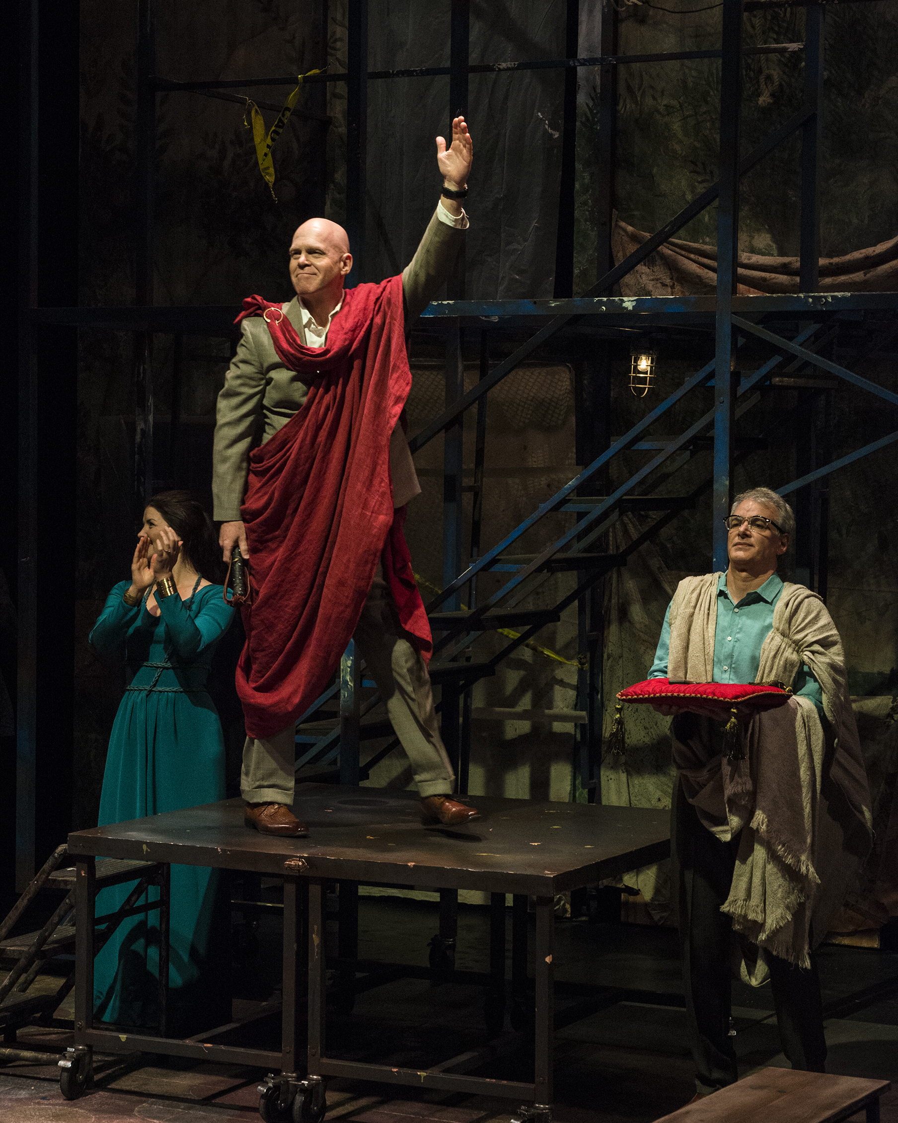 "L-R: Rosie Ward as Calphurnia, Paul Sandberg as Julius Caesar, Andrew May as Casca in the Utah Shakespeare Festival's 2016 production of ""Julius Caesar."" Cedar City, Utah, date not specified 