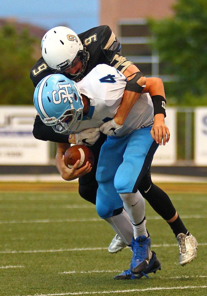 Desert Hills' Carter Reynolds (9) sacks the Salem Hills quarterback, Desert Hills vs. Salem Hills, Football, St. George, Utah, Aug. 26, 2016, | Photo by Robert Hoppie, ASPpix.com, St. George News
