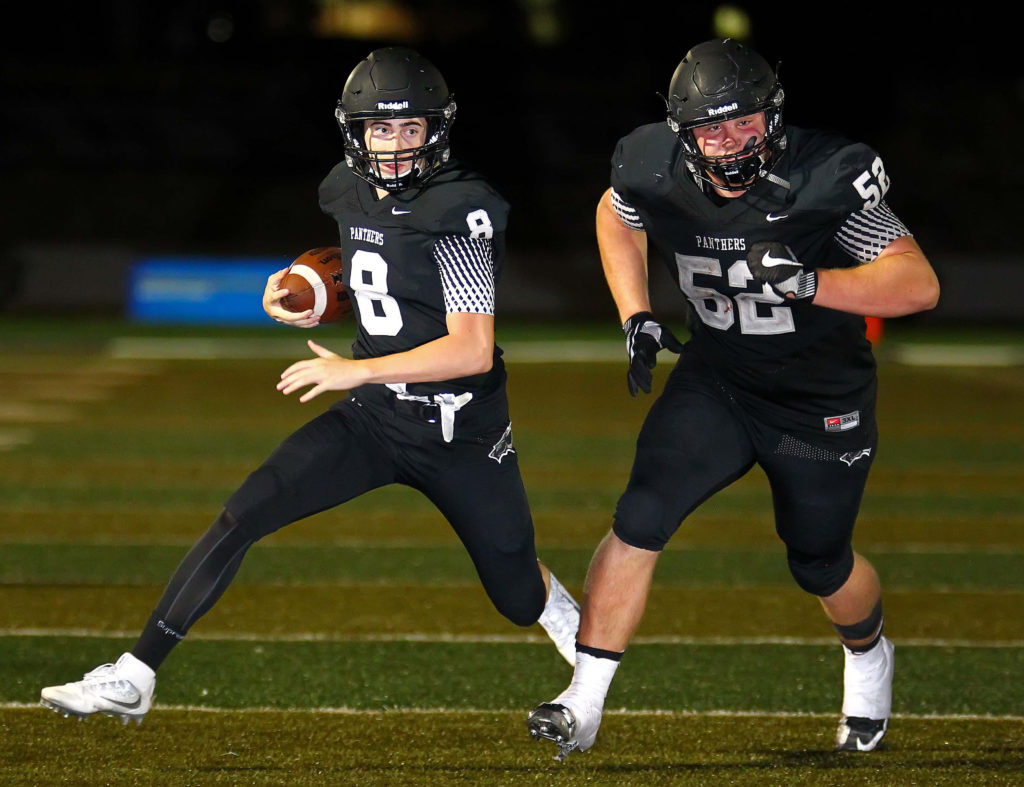 Pine View's Tyler Heaton (52) leads the way for Jacob Brann (8), Pine View vs. Uintah, Football, St. George, Utah, Aug. 26, 2016, | Photo by Robert Hoppie, ASPpix.com, St. George News