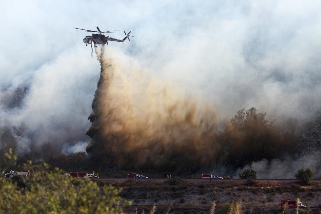 A helitanker does a water drop on hot spots during a wildfire near Cajon Boulevard in Devore, Calif., Thursday, Aug. 18, 2016 | Photo by David Pardo/The Daily Press via AP; St. George News