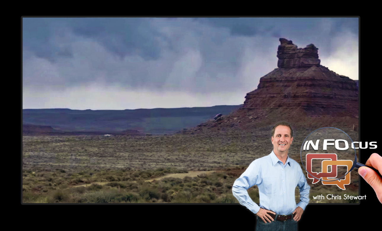 Background: Bears Ears region in Utah, which is being considered for national monument designation by the Obama administration. Foreground: Utah Congressman Chris Stewart | Photo courtesy of Sutherland Institute via YouTube, St. George News