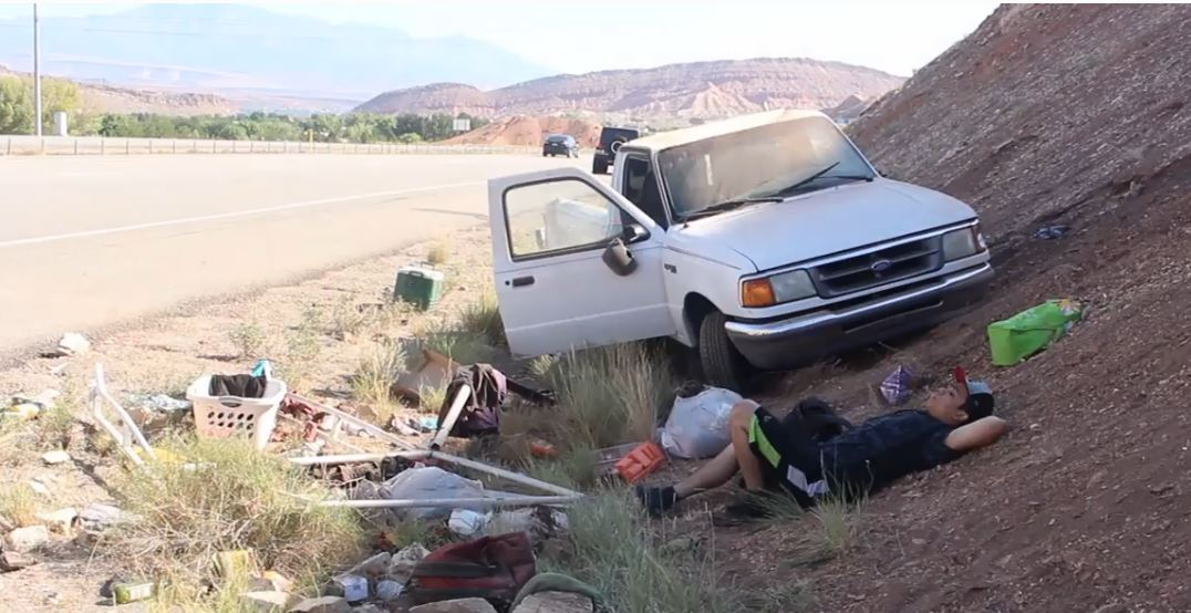 A driver on northbound Interstate 15 reached for his cellphone, lost control of his truck, spun around and left the roadway backwards before being ejected from his truck after crashing into a hillside near milepost 3, St. George, Utah, Aug. 17, 2016 | Photo by Mike Cole, St. George News