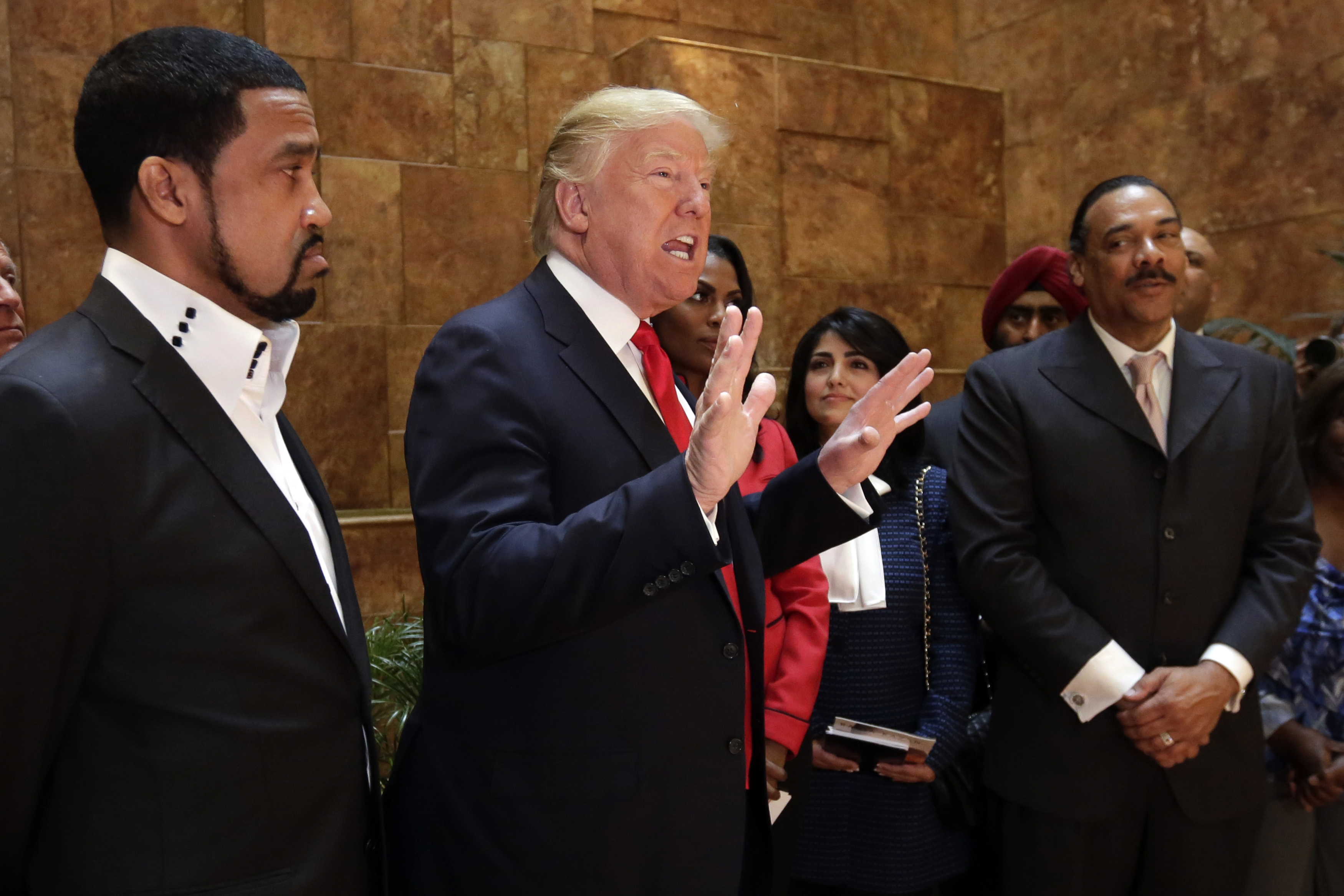 "In this April 18, 2016 file photo, Pastor Darrell Scott listens at left as Republican presidential candidate Donald Trump speaks in Trump Tower building in New York. Competing appearances earlier this month by Trump and Hillary Clinton highlight an oft-overlooked political reality: The ""religious vote"" is vast and complex, and it extends beyond generalizations about ""social conservatives"" who side with Republicans and black Protestant churches whose pastors and parishioners opt nearly unanimously for Democrats. 