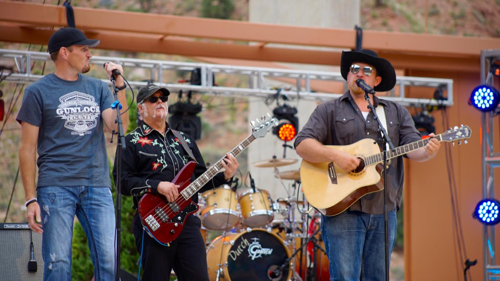 Eric Dodge joins Gunlock County on the O.C. Tanner Amphitheater stage, Springdale, Utah, summer, 2016 | Photo courtesy of Emceesquare Media Inc., St. George News