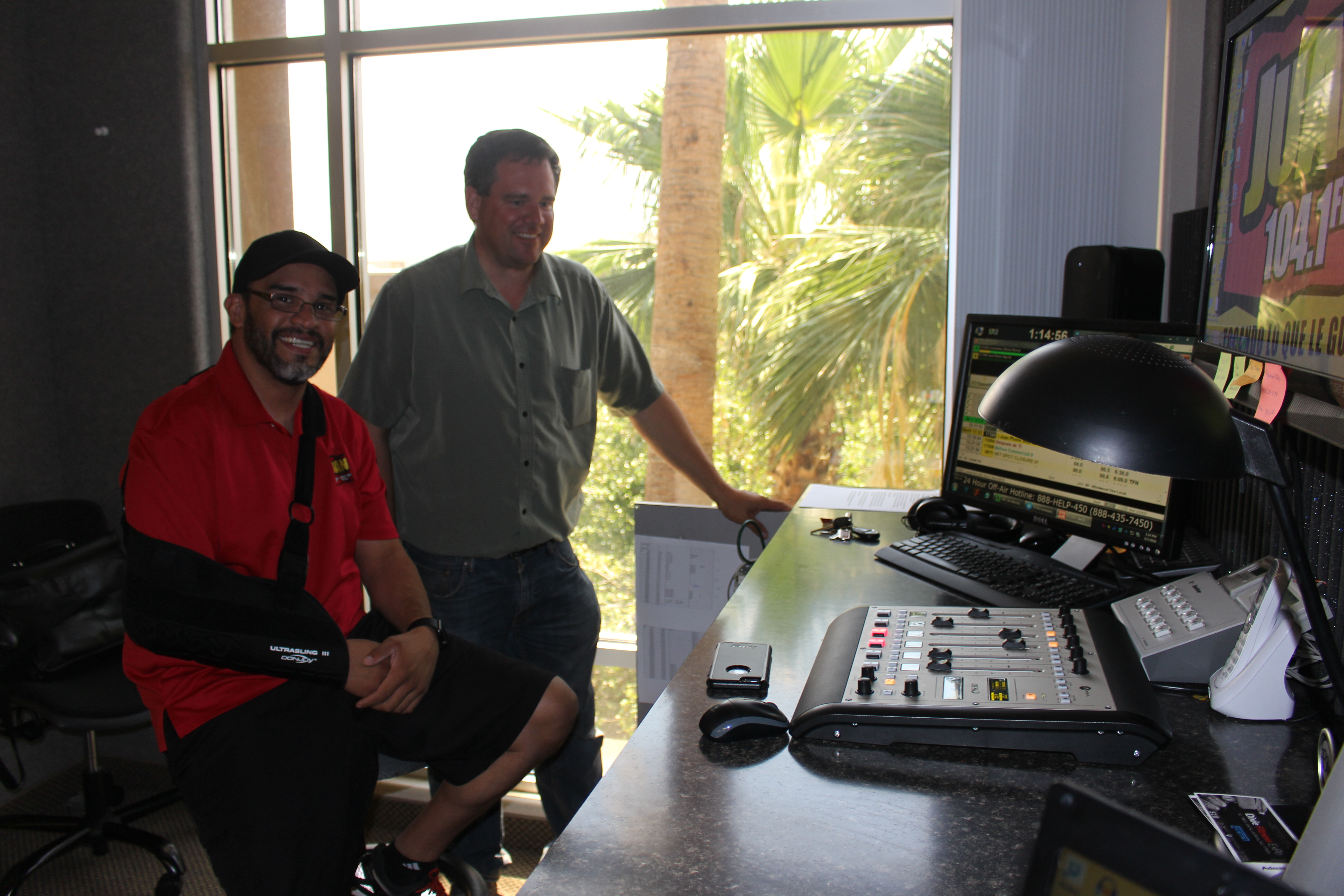 Canyon Media Chief Engineer Kelton Lloyd visits with Juan 104.5 morning personality Pedro XXXX , St. George, Utah, Aug. 3, 2016 | Photo by Ric Wayman, St. George News