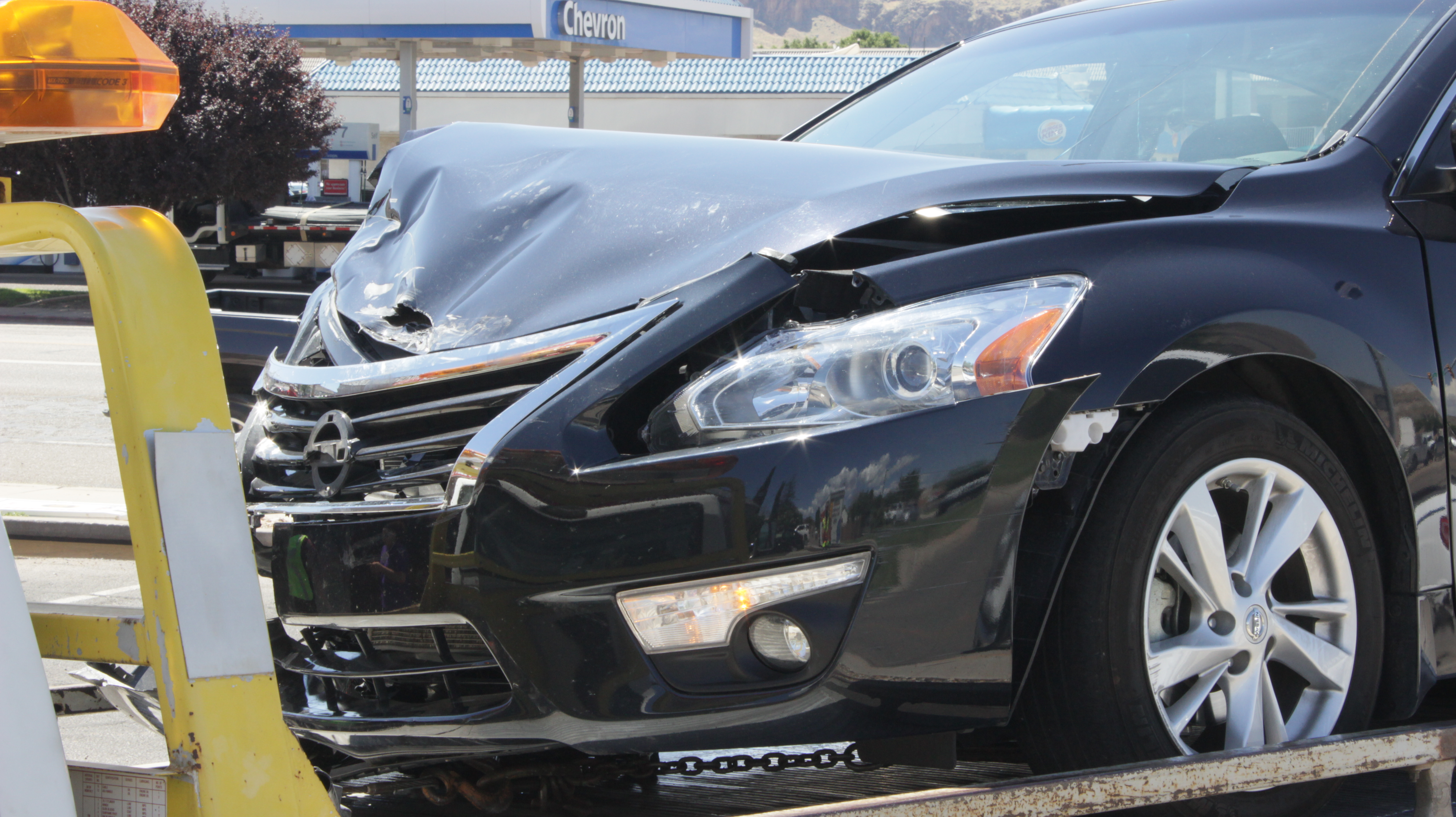 A collision between a Nissan Altima and a U-Haul moving truck left the Nissan worse for wear Friday afternoon, Aug. 12, Hurricane, Utah | Photo by Don Gilman, St. George News
