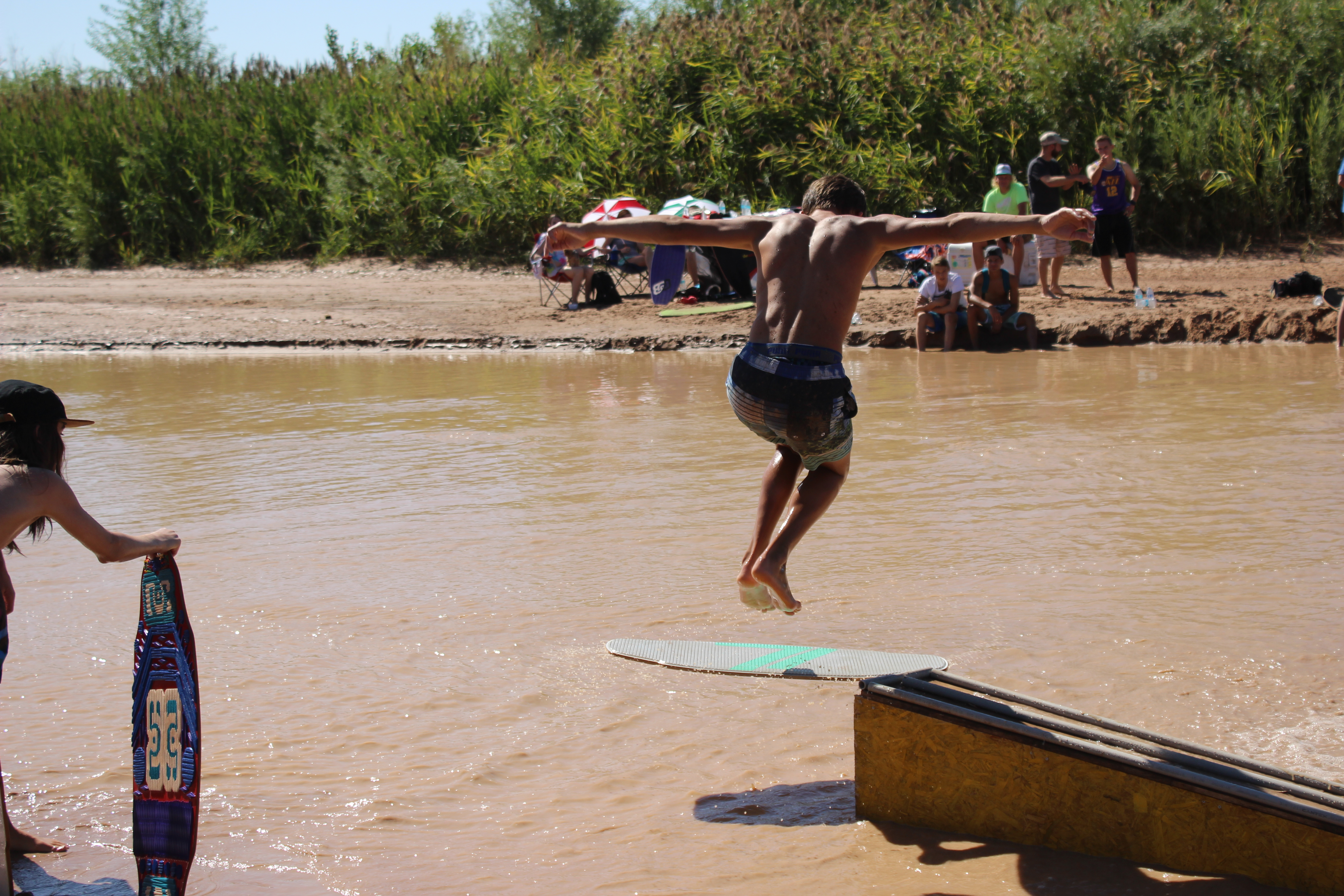 A competitor in the 1st Annual Skimapalooza skimboarding competition gets airborn while attempting a trick, St. George, Utah, Aug. 13, 2016 | Photo by Don Gilman, St. George News