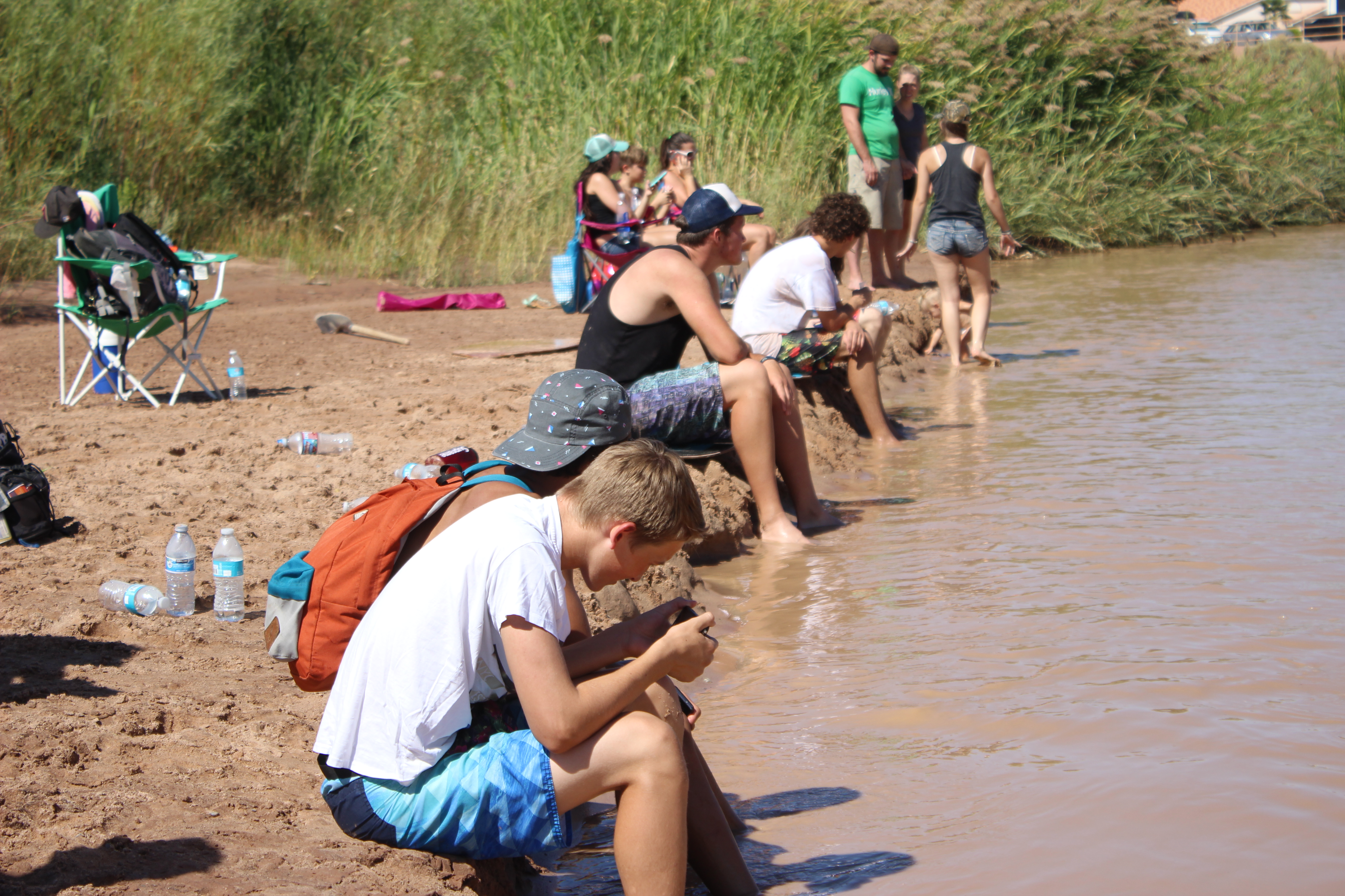 Onlookers enjoy the warm temperatures and cool water during the 1st Annual Skimapalooza skimboarding competition, St. George, Utah, Aug. 13, 2016 | Photo by Don Gilman, St. George News