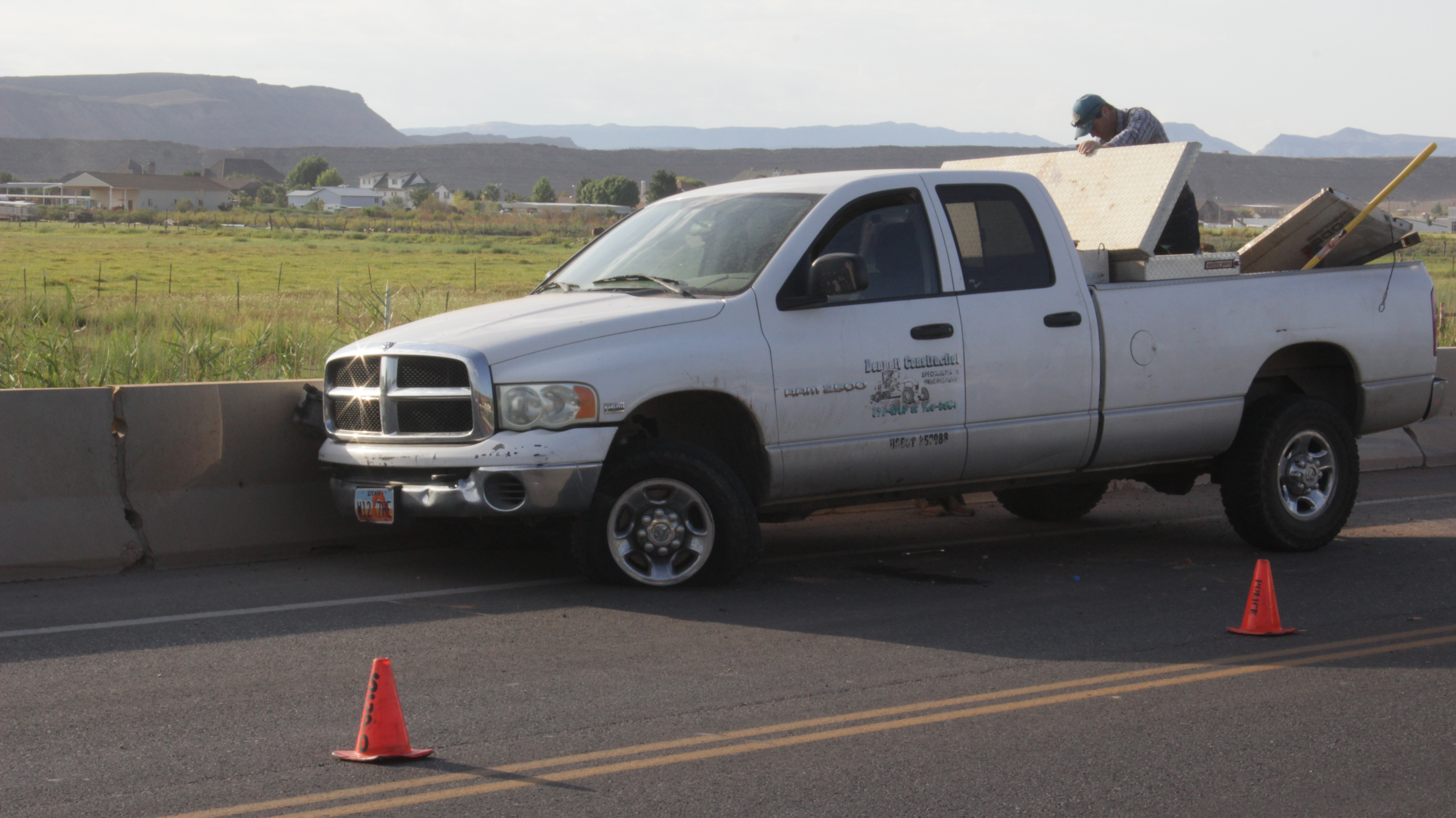 A driver attempting to reach for his medication slammed into a concrete barrier Thursday morning, St. George, Utah, Aug 18, 2016 | Photo by Don Gilman, St. George News