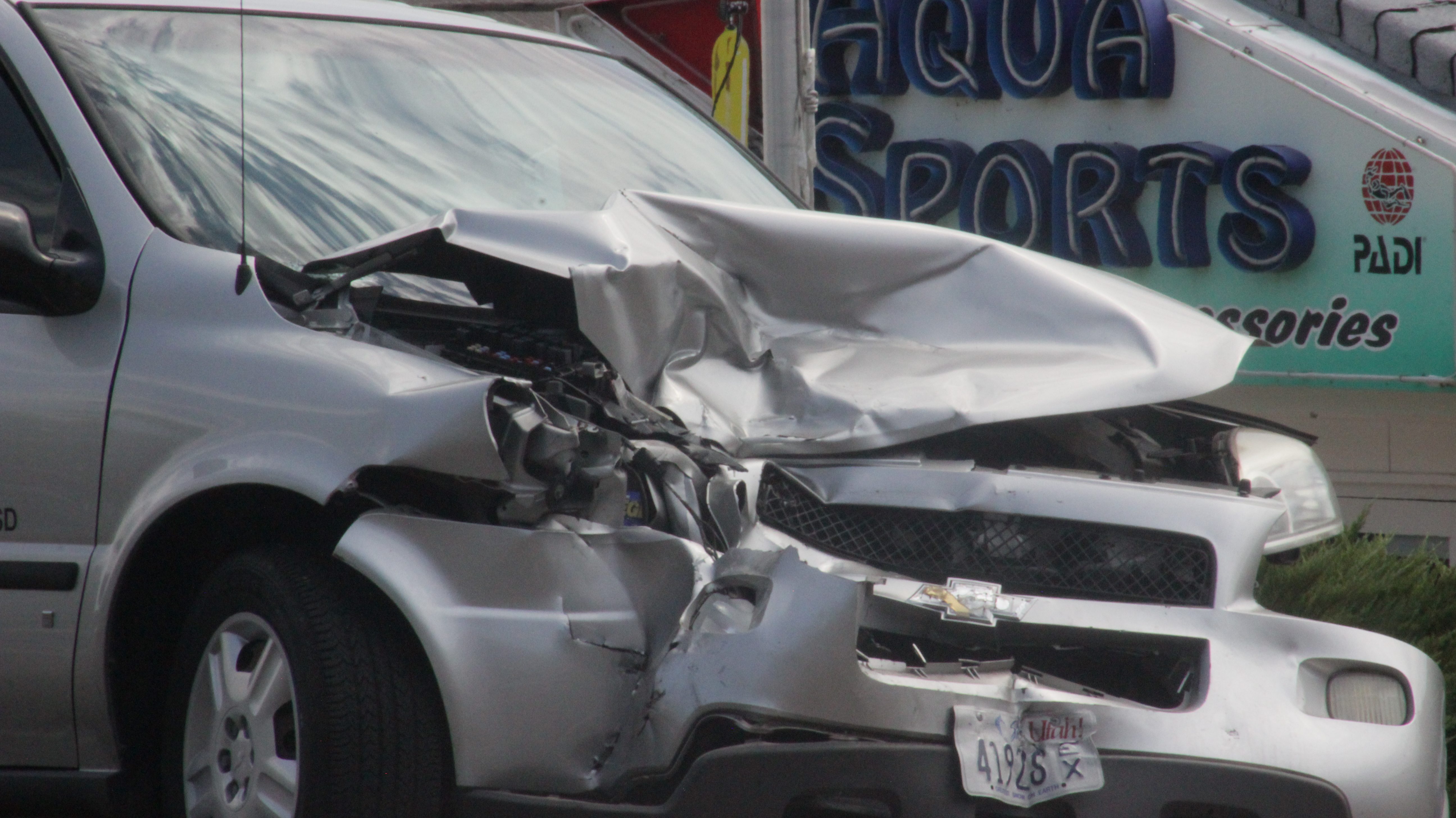 A collision between a Chevy truck and a Chevy minivan left both vehicles inoperable and resulted in a failure to yield citation for the driver of the truck, St. George, Utah, Aug 18, 2016 | Photo by Don Gilman, St. George News