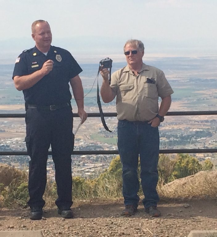 L-R: Cedar City Fire Chief Mike Phillips, Southwest Wildlife Foundation of Utah founder and CEO Martin Tyner. Phillips speaks at an eagle release Friday in honor of first responders. Cedar City, Utah, Aug. 19, 2016 | Photo by Austin Sullivan, St. George News / Cedar City News