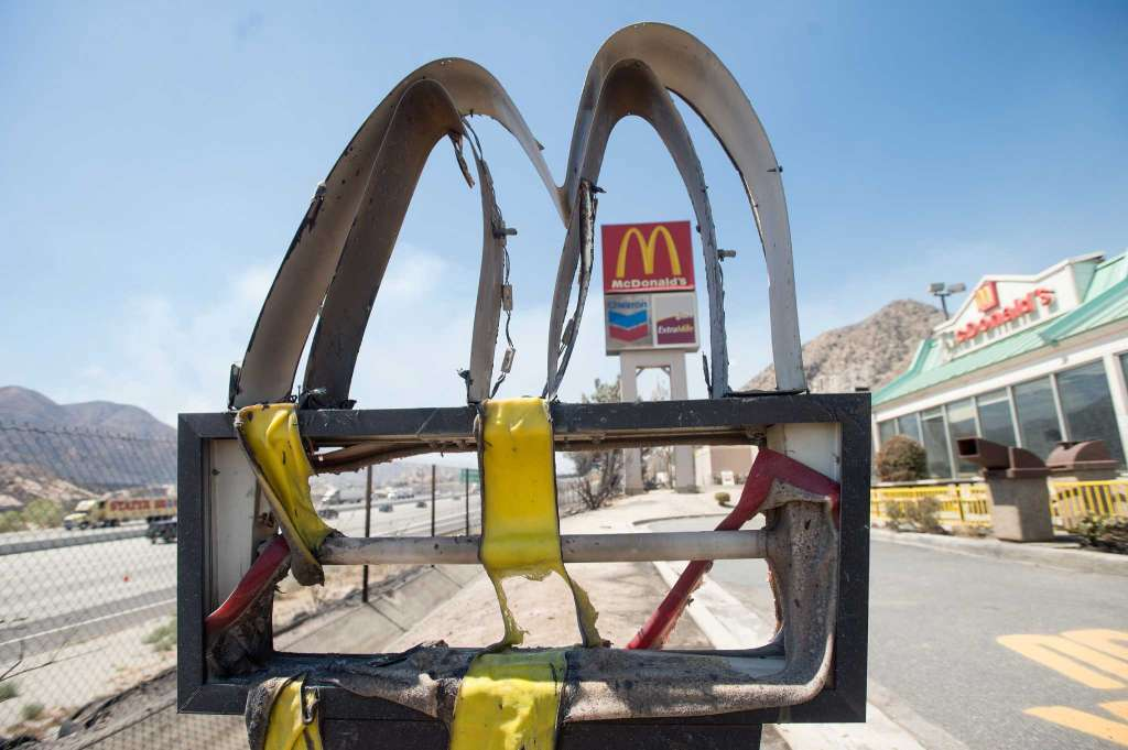 Following a wildfire, a melted McDonald's sign stands outside a restaurant in Cajon Junction, Calif., on Thursday, Aug. 18, 2016. Scenes of destruction were everywhere Thursday after a huge wildfire sped through mountains and high desert 60 miles east of Los Angeles so swiftly that it took seasoned firefighters off guard. | AP Photo/Noah Berger; St. George News