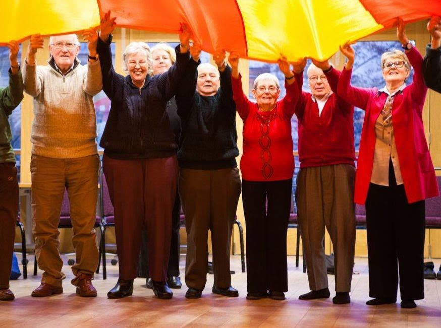 Participants in a Memory Matters course enjoy a colorful parachute activity, location and date not specified | Photo courtesy of Memory Matters Utah, St. George News