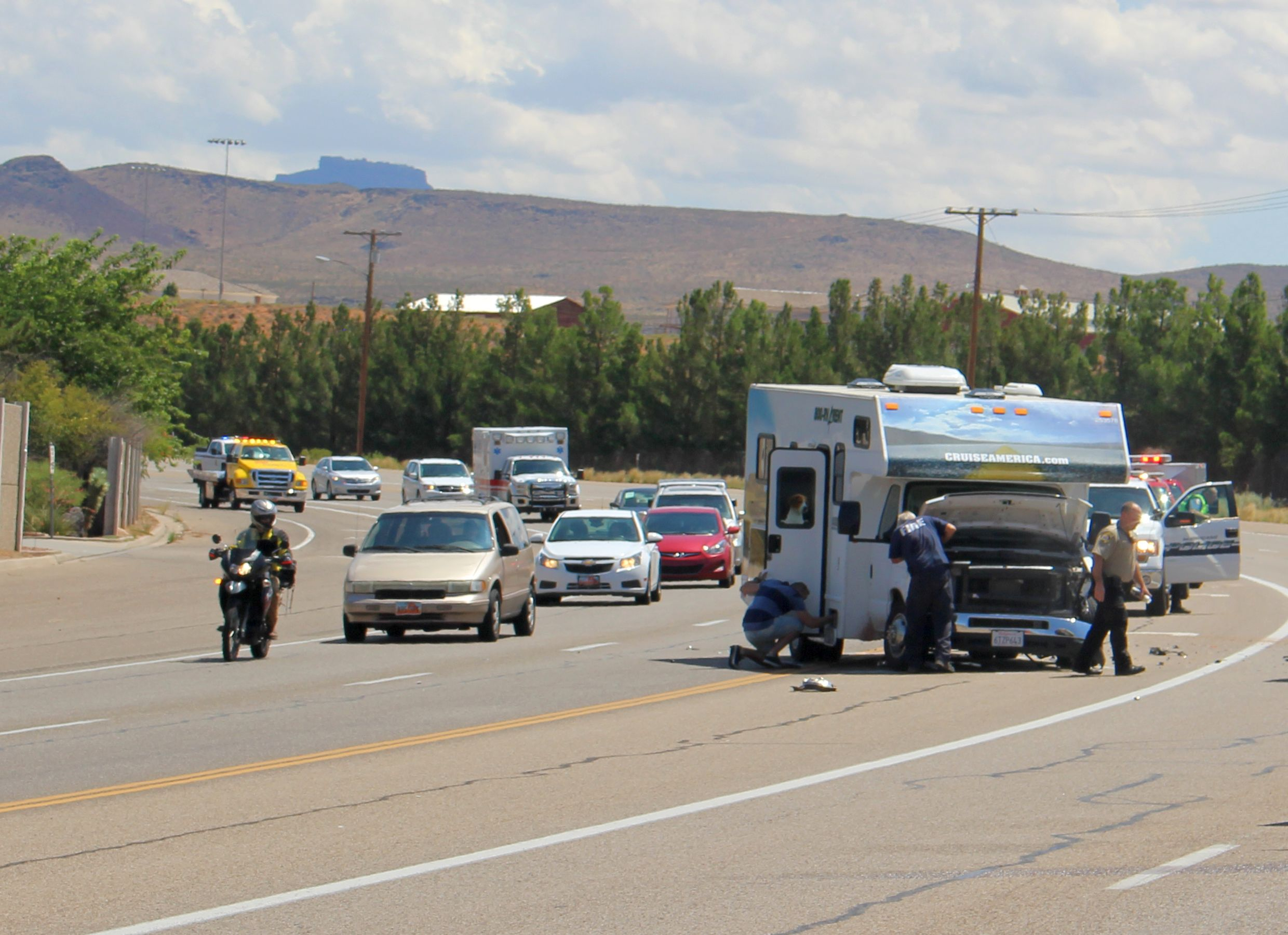 A wrecked motor home sits in the middle of state Route 9 after a collision with an SUV. At the left is a motorcycle followed by a minivan that was involved in a second accident seconds after this picture was taken. Hurricane, Utah, Aug. 6, 2016 | Photo by Ric Wayman, St. George News