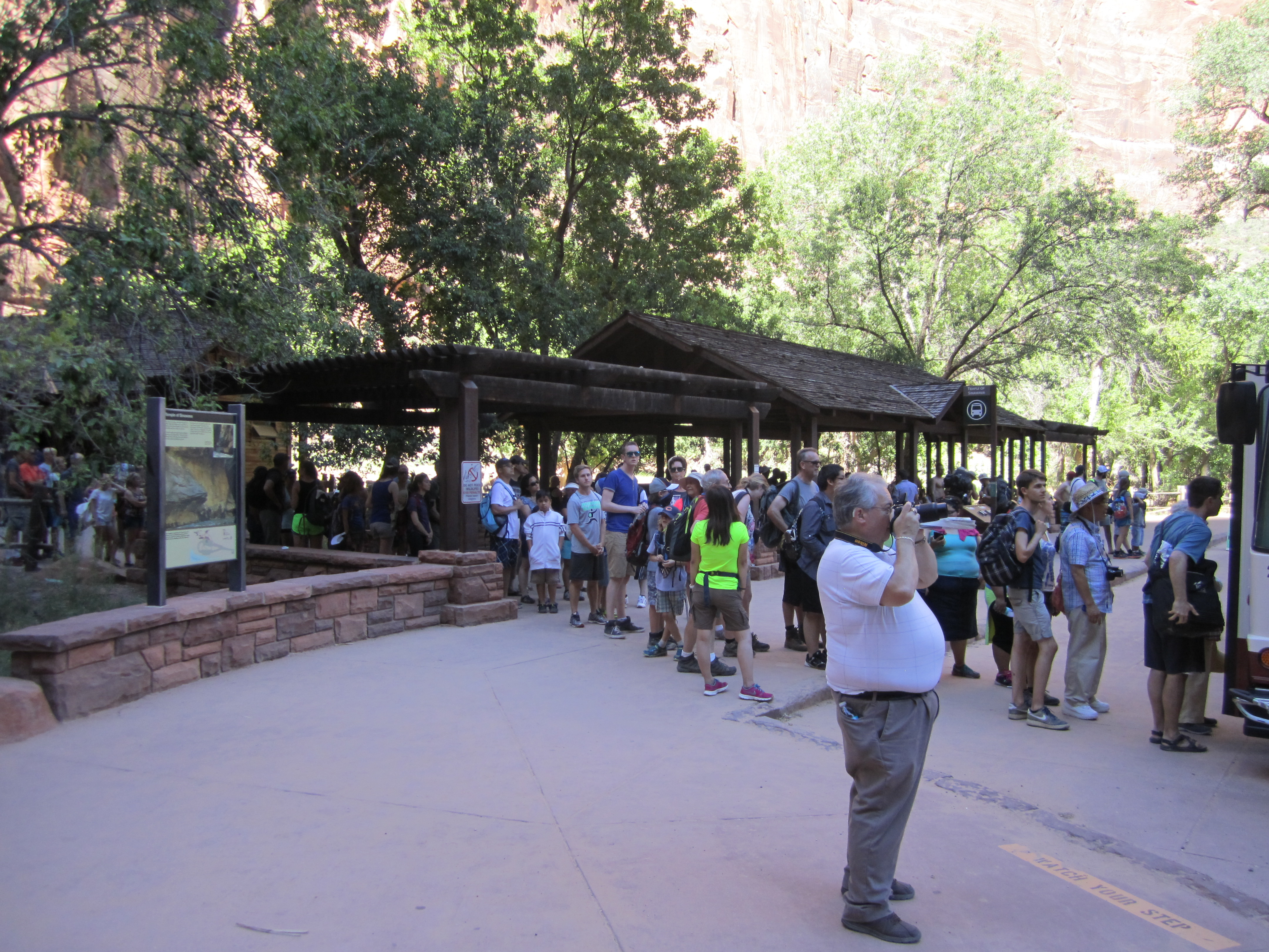 Visitors stand in line to board the shuttle at the Temple of Sinawava, the Riverside Walk Trailhead and terminus of the Zion Canyon Scenic Drive. Zion National Park, Utah, July 25, 2015 | Photo courtesy of Zion National Park, St. George News