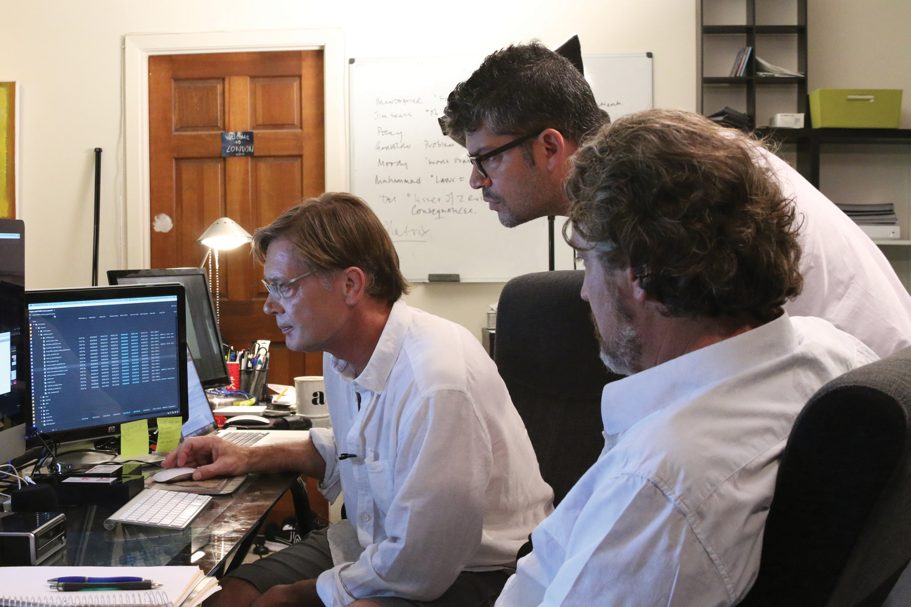 """Director Andrew Wakefield (left), Editor Brian Burrows (middle) and Producer Del Bigtree (Right) review the data from the Centers for Disease Control and Prevention autism/MMR study. Location and date not specified 