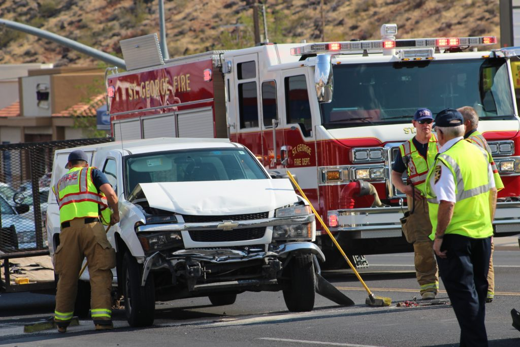 White Chevrolet pickup after two collisions that happened seconds apart on Bluff Street Thursday, St. George, Utah, Aug. 25, 2016 | Photo by Cody Blowers, St. George News