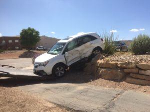 White Dodge SUV involved in two-car collision after driver runs stop sign on River Road and Commerce Drive, Aug. 11, 2016 | Photo by Cody Blowers, St. George News