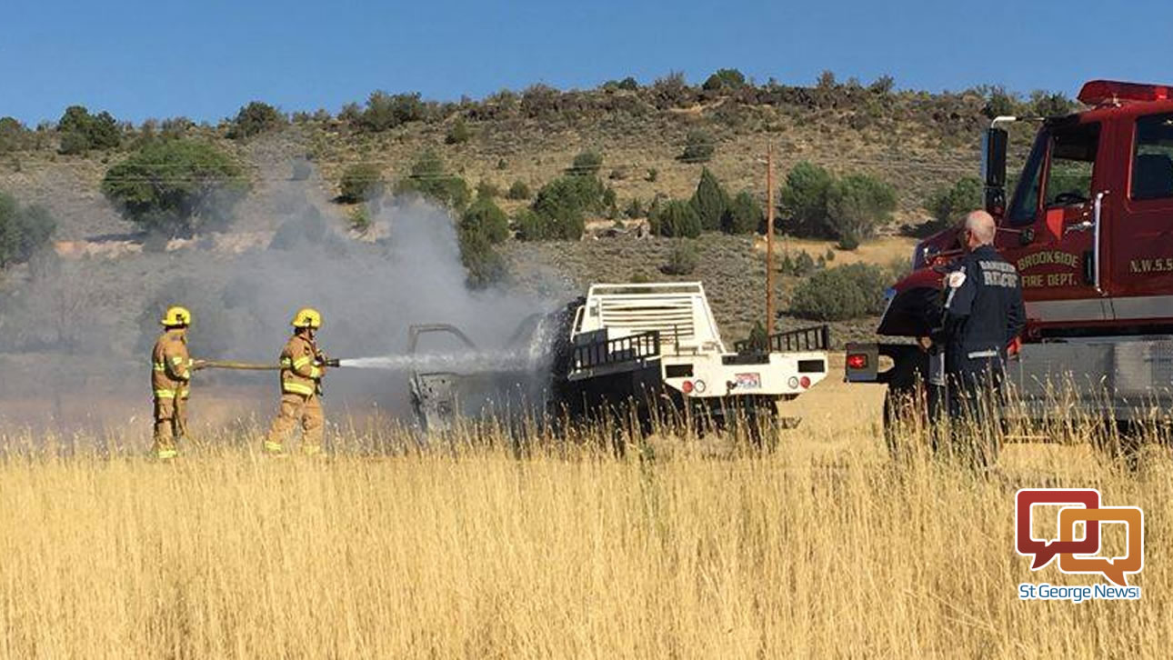 Firefighters work to put out a vehicle fire on state Route 18 Tuesday afternoon. Veyo, Utah, Aug. 9, 2016 | Photo courtesy of Kathie Mason, St. George News