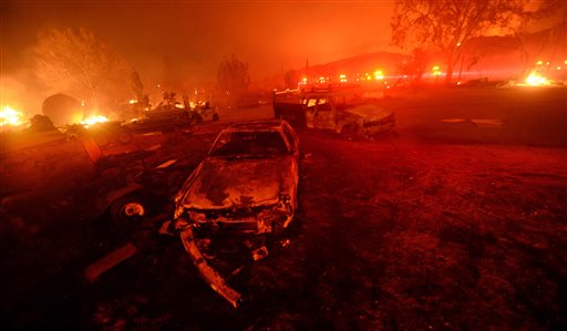 A wildfire burns in the Cajon Pass in San Bernardino County, Calif., on Tuesday. The wildfire that began as a small midmorning patch of flame next to Interstate 15 in the Cajon Pass had by Wednesday afternoon turned into a 47-square-mile monster that burned an untold number of homes. San Bernardino County, California, Aug. 16, 2016   Photo by Will Lester/The Inland Valley Daily Bulletin via AP, St. George News