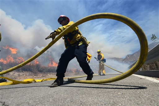 Firefighters battle the Bluecut Fire along Swarthout Canyon Road in the Cajon Pass, north of San Bernardino, Calif., Tuesday. Officials with the San Bernardino National Forest say five years of drought coupled with dry, hot weather have turned the entire area into a tinder box. San Bernardino County, California, Aug. 16, 2016 | Photo by Will Lester/The Sun via AP, St. George News