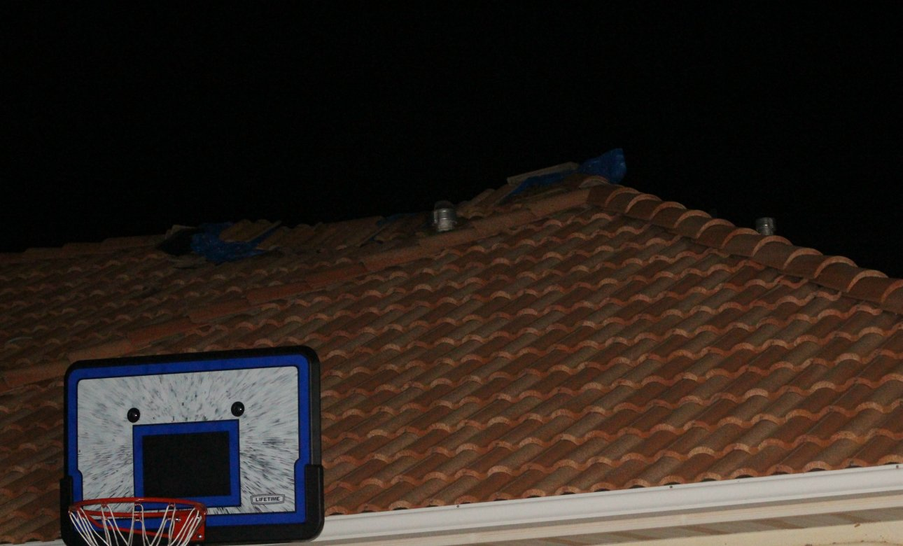 A tarp held down by broken roof tile shows the spot where lightning struck a home in Ivins and blew a hole in the roof, Ivins, Utah, Aug. 23, 2016 | Photo by Mori Kessler, St. George News