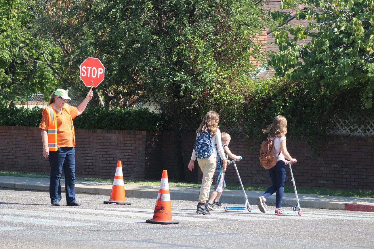 Long-time crossing guard Jathy Bruhm at the intersection of 700 South and 600 East in St. George, Utah, Aug. 23, 2016 | Photo by Mori Kessler, St. George News
