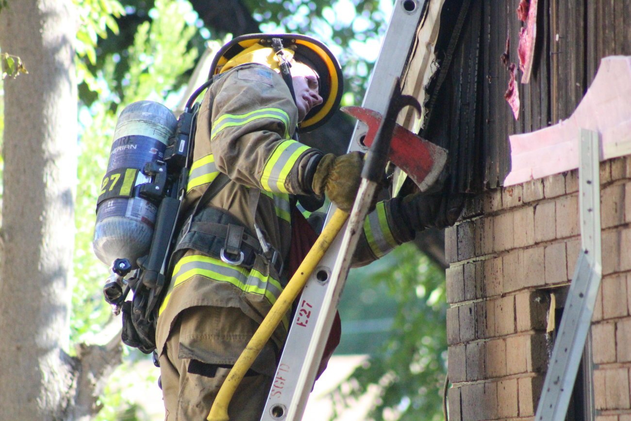 An outdoor fire scorched the side of a home on 600 North. charring brick and melting siding before it was extinguished, firefighters investigated the attic area to make sure the sure hadn't slipped into that part of the home, St. George, Utah, Aug. 16, 2016 | Photo by Mori Kessler, St. George News