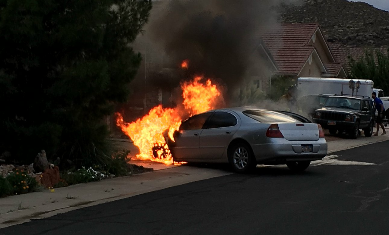 A 2003 Chrysler 300M on Grouse Drive in Hurricane was partially consumed by fire. Though the car was a loss, no one was hurt as a result of the fire, Hurricane, Utah, Aug. 22, 2016 | Photo courtesy of Tanner Bo, St. George News